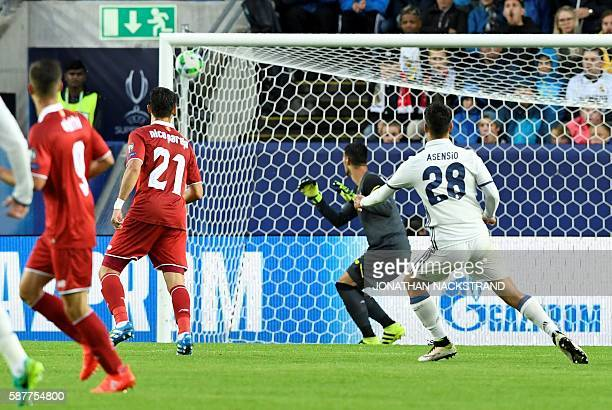 Real Madrid's Spanish midfielder Marco Asensio scores during the UEFA Super Cup final football match between Real Madrid CF and Sevilla FC on August...