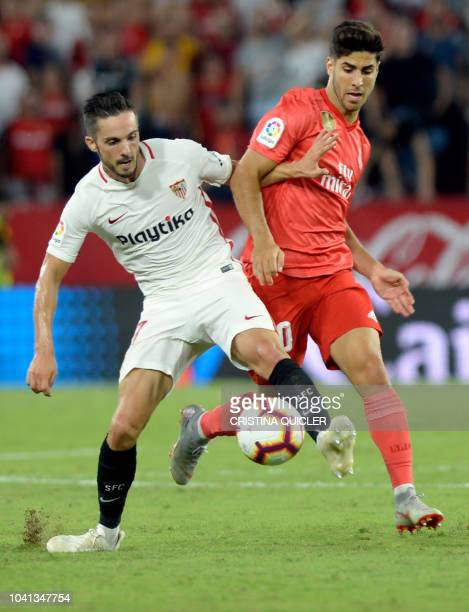 Real Madrid's Spanish midfielder Marco Asensio vies with Sevilla's Spanish midfielder Pablo Sarabia during the Spanish league football match Sevilla...