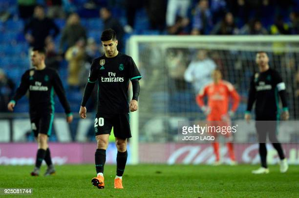 Real Madrid's Spanish midfielder Marco Asensio walks on the field after Espanyol's goal during the Spanish league football match between RCD Espanyol...
