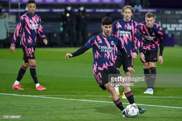 Real Madrid's Spanish midfielder Marco Asensio warms up before during the Spanish league football match between Real Valladolid FC and Real Madrid CF...