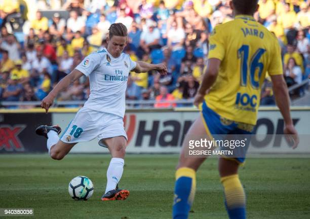 Real Madrid's Spanish midfielder Marcos Llorente shoots during the Spanish League football match between UD Las Palmas and Real Madrid CF at the Gran...