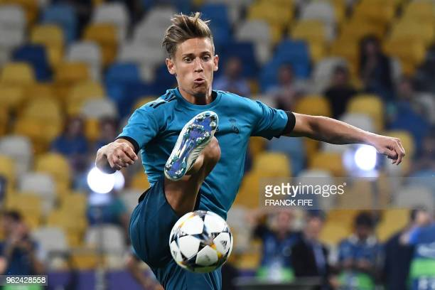 Real Madrid's Spanish miedfieder Marcos Llorente controls the ball during a Real Madrid team training session at the Olympic Stadium in Kiev Ukraine...