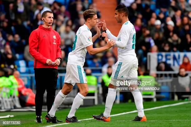 Real Madrid's Spanish miedfieder Marcos Llorente enter the pitch to replace Real Madrid's Brazilian midfielder Casemiro during the Spanish league...