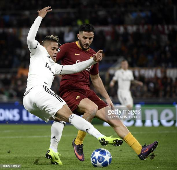 Real Madrid's SpanishDominican forward Mariano and AS Roma Greek defender Konstantinos Manolas go for the ball during the UEFA Champions League group...