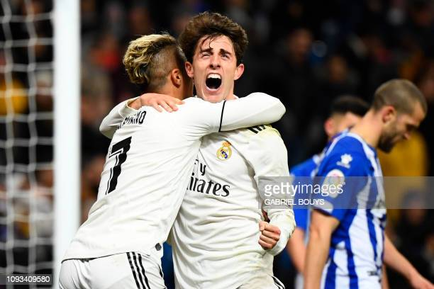 TOPSHOT Real Madrid's SpanishDominican forward Mariano celebrates his goal with Real Madrid's Spanish defender Alvaro Odriozola during the Spanish...