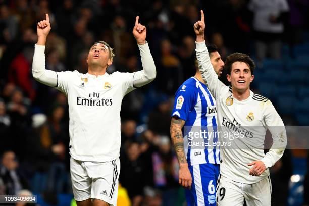 Real Madrid's SpanishDominican forward Mariano celebrates his goal with Real Madrid's Spanish defender Alvaro Odriozola during the Spanish league...