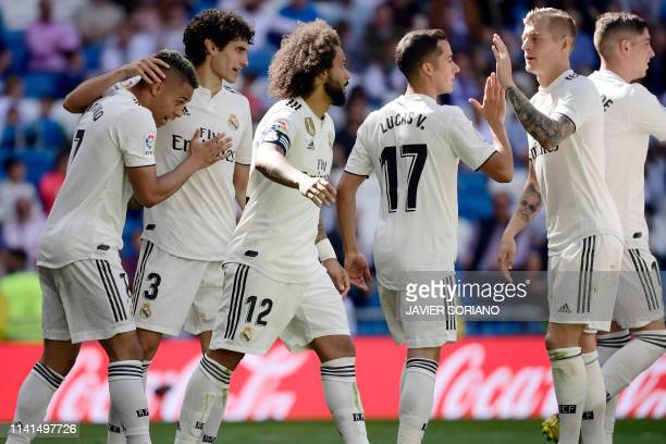 Real Madrid's SpanishDominican forward Mariano celebrates his second goal with teammates during the Spanish league football match between Real Madrid...