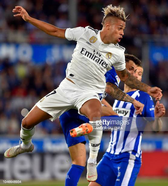 Real Madrid's SpanishDominican forward Mariano jumps during the Spanish league football match between Deportivo Alaves and Real Madrid CF at the...