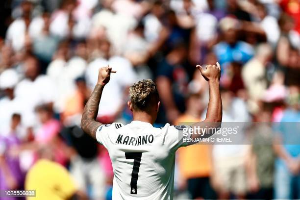 Real Madrid's Spanish-Dominican forward Mariano poses with his new number 7 jersey during his official presentation at the Santiago Bernabeu Stadium...