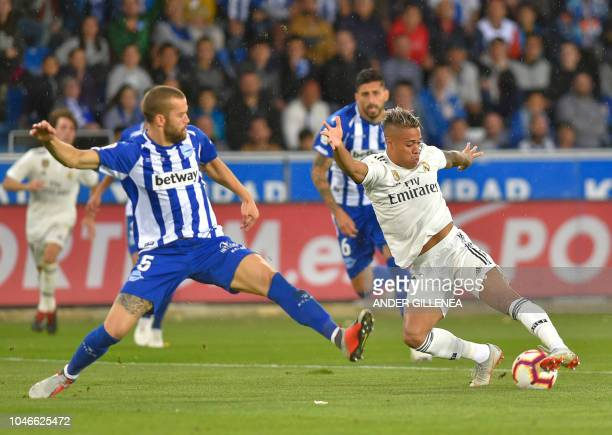 Real Madrid's SpanishDominican forward Mariano vies with Alaves' Spanish defender Victor Laguardia during the Spanish league football match between...