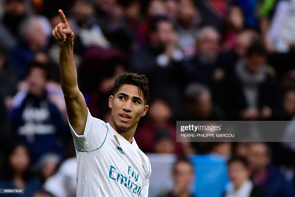 Real Madrid's Spanish-Moroccan defender Achraf Hakimi celebrates after scoring his team's fifth goal during the Spanish league football match between Real Madrid and Sevilla at the Santiago Bernabeu Stadium in Madrid on December 9, 2017. /