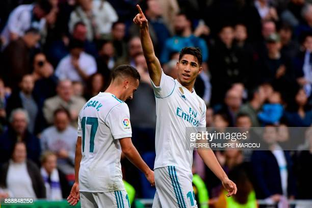 Real Madrid's SpanishMoroccan defender Achraf Hakimi celebrates with Real Madrid's Spanish midfielder Lucas Vazquez after scoring his team's fifth...