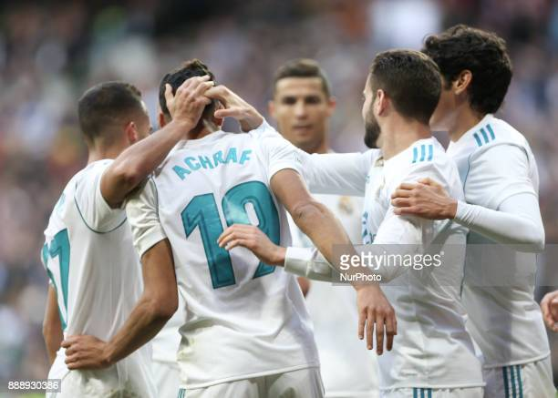 Real Madrid's SpanishMoroccan defender Achraf Hakimi celebrates with his teammate after scoring his team's fifth goal during the Spanish league...