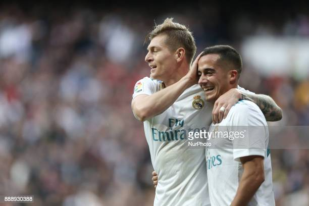 Real Madrid's SpanishMoroccan defender Achraf Hakimi celebrates with Toni Kroos after scoring his team's fifth goal during the Spanish league...