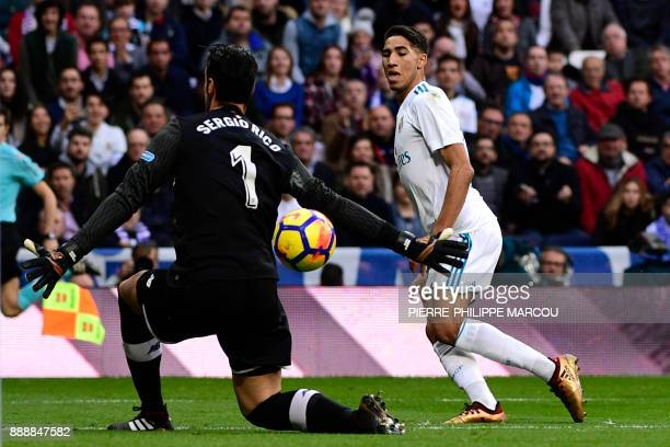 Real Madrid's SpanishMoroccan defender Achraf Hakimi scores his team's fifth goal past Sevilla's Spanish goalkeeper Sergio Rico Gonzalez during the...