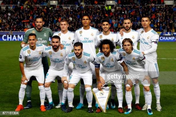 Real Madrid's starting eleven pose for a group picture ahead of the UEFA Champions League Group H match between Apoel FC and Real Madrid on November...