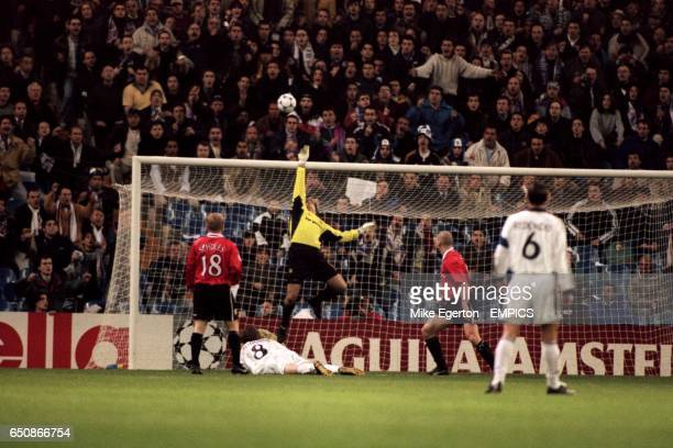 Real Madrid's Steve McManaman has his shot saved by Manchester United goalkeeper Mark Bosnich