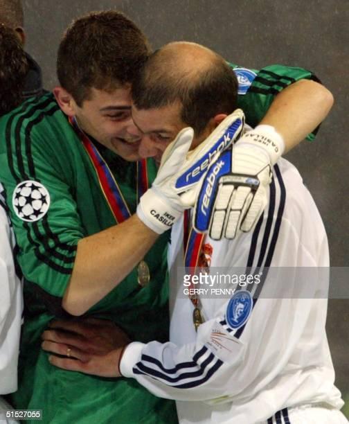 Real Madrid's substitute goalkeeper Iker Casillas hugs teammate Zinedine Zidane after the team defeated Bayer Leverkusen in the Champions League...