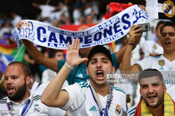 Real Madrid's supporters cheer prior to the UEFA Champions League final football match between Liverpool and Real Madrid at the Olympic Stadium in...