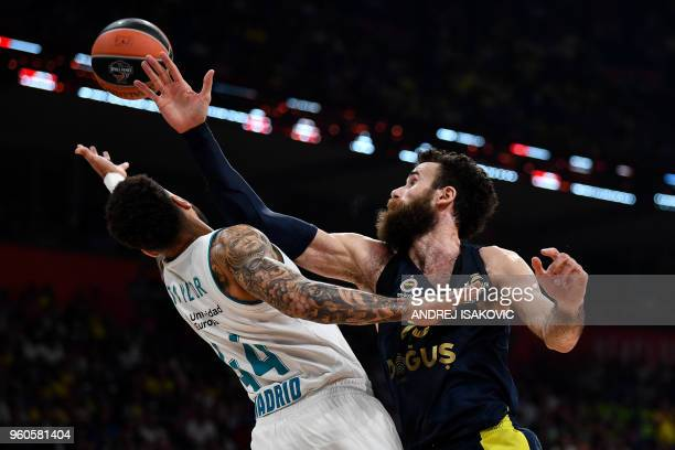 TOPSHOT Real Madrid's Swedish forward Jeffery Taylor fights for the ball with Fenerbahce's Italian forward Luigi Datome during the Euroleague Final...