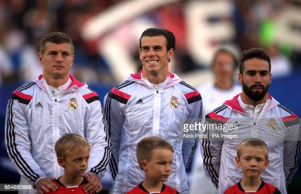 Real Madrid's Toni Kroos Gareth Bale and Daniel Carvajal line up before the UEFA Super Cup Final at the Cardiff City Stadium Cardiff