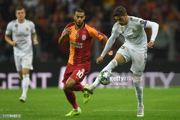 Real Madrid's Uruguayan midfielder Federico Valverde controls the ball in front of Galatasaray's Moroccan midfielder Younes Belhanda during the UEFA...