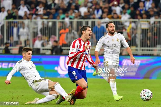 Real Madrid's Uruguayan midfielder Federico Valverde fouls Atletico Madrid's Spanish forward Alvaro Morata during the Spanish Super Cup final between...
