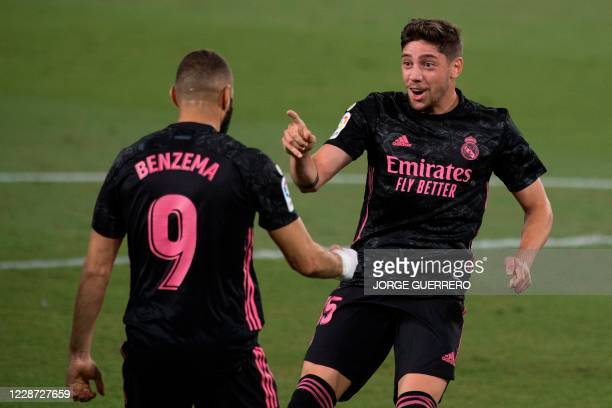 Real Madrid's Uruguayan midfielder Valverde celebrates with French forward Karim Benzema after scoring during the Spanish league football match Real...