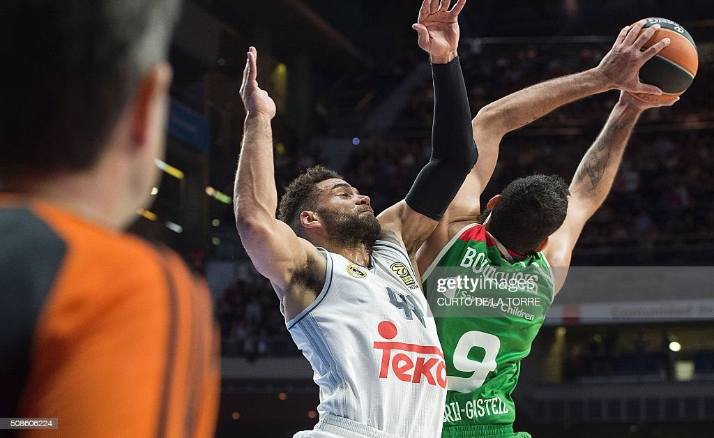 Real Madrid's US forward Jeffery Taylor (L) vies with Laboral's Greek center Ioannis Bourousis during the Euroleague group F Top 16 round 6 basketball match Real Madrid vs Laboral Kutxa Vitoria Gasteiz at the Palacio de Deportes de la Comunidad de Madrid (Barclaycard Center) in Madrid on February 5, 2016.