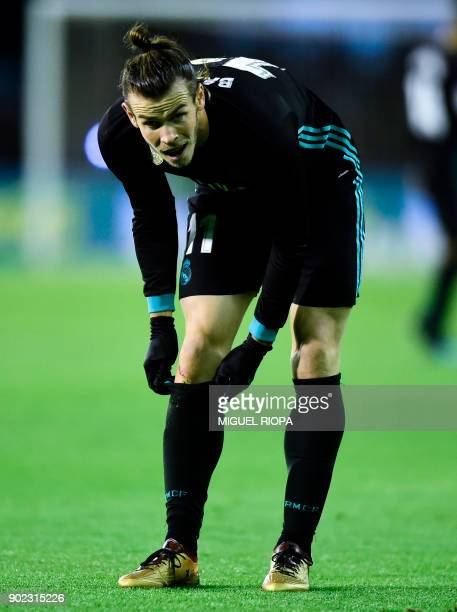 Real Madrid's Welsh forward Gareth Bale adjusts his socks during the Spanish league football match Celta de Vigo vs Real Madrid at the Balaidos...