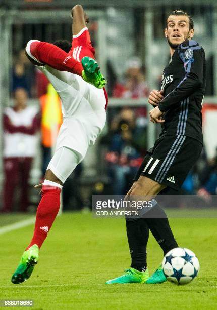 Real Madrid's Welsh forward Gareth Bale and Bayern Munich's Austrian defender David Alaba vie for the ball during the firstleg quarter final...