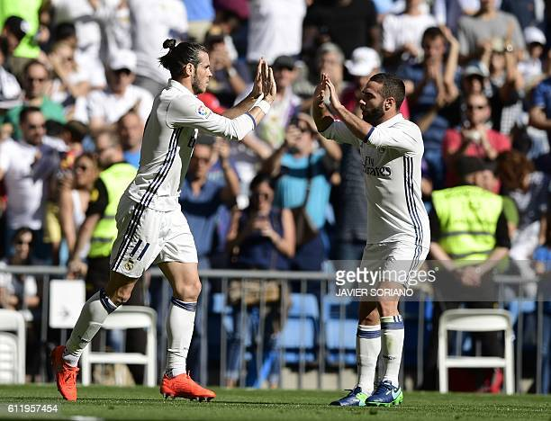 Real Madrid's Welsh forward Gareth Bale and Real Madrid's defender Dani Carvajal celebrate after scoring a goal during the Spanish league football...