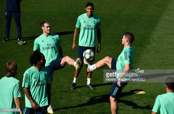 Real Madrid's Welsh forward Gareth Bale and Real Madrid's Serbian forward Luka Jovic attend a training session at the Valdebebas training complex in...