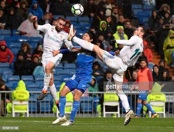 TOPSHOT Real Madrid's Welsh forward Gareth Bale and Real Madrid's Spanish defender Dani Carvajal vie with Getafe's Japanese midfielder Gaku Shibasaki...