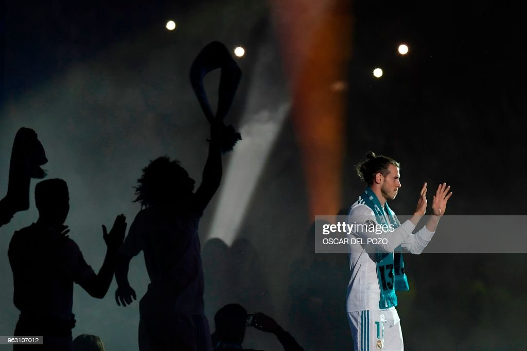 Real Madrid's Welsh forward Gareth Bale arrives at the Santiago Bernabeu stadium in Madrid on May 27, 2018 for a victory ceremony after Real Madrid won its third Champions League title in a row in ...