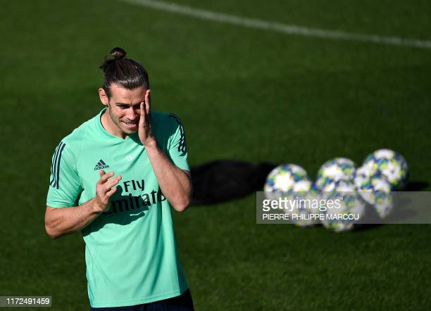 Real Madrid's Welsh forward Gareth Bale attends a training session at the Valdebebas training complex in the outskirts of Madrid on September 30 on...