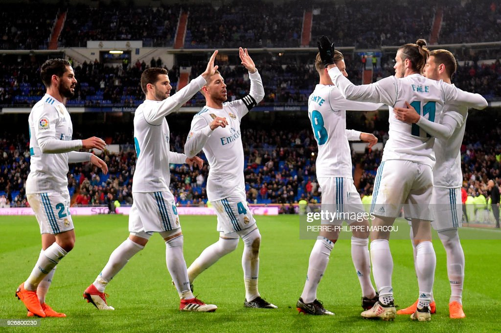 Real Madrid's Welsh forward Gareth Bale (2R) celebrates a goal with teammates during the Spanish league football match Real Madrid CF against Getafe CF at the Santiago Bernabeu stadium in Madrid on March 3, 2018. /