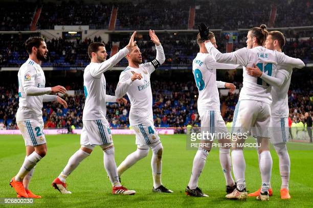 Real Madrid's Welsh forward Gareth Bale celebrates a goal with teammates during the Spanish league football match Real Madrid CF against Getafe CF at...