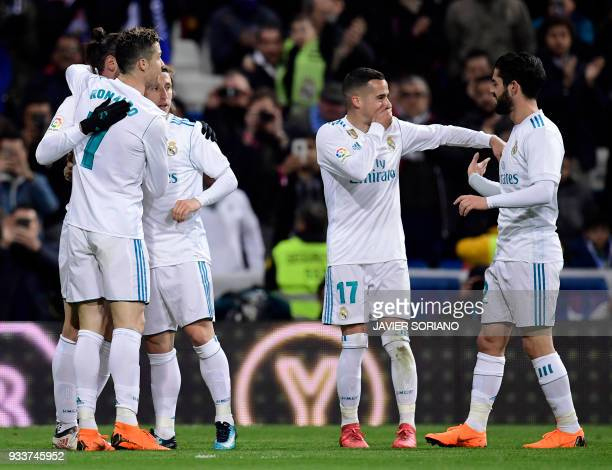 Real Madrid's Welsh forward Gareth Bale celebrates a goal with teammates during the Spanish League football match between Real Madrid CF and Girona...
