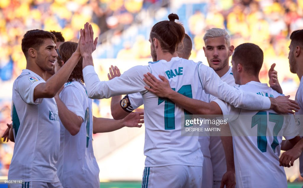 Real Madrid's Welsh forward Gareth Bale (C) celebrates a goal with teammates during the Spanish League football match between UD Las Palmas and Real Madrid CF at the Gran Canaria stadium in Las Palmas on March 31, 2018. /