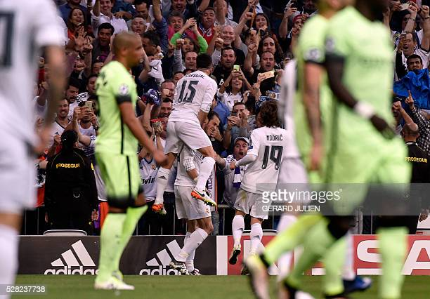 Real Madrid's Welsh forward Gareth Bale celebrates a goal with Real Madrid's defender Dani Carvajal during the UEFA Champions League semi-final...