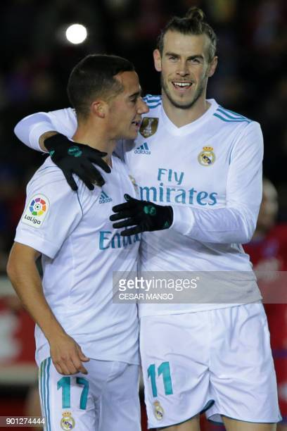 Real Madrid's Welsh forward Gareth Bale celebrates a goal with Real Madrid's Spanish midfielder Lucas Vazquez during the Spanish Copa del Rey round...