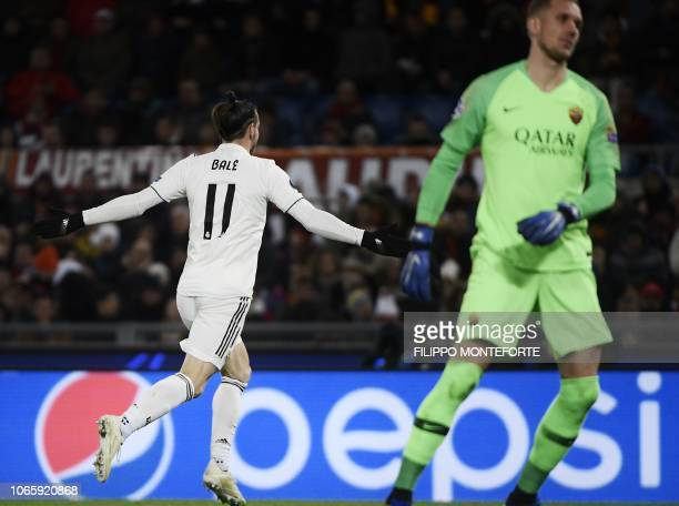 Real Madrid's Welsh forward Gareth Bale celebrates after opening the scoring as AS Roma Swedish goalkeeper Robin Olsen reacts during the UEFA...
