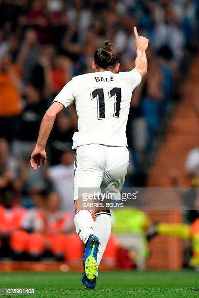 Real Madrid's Welsh forward Gareth Bale celebrates after scoring a goal during the Spanish league football match between Real Madrid CF and Club...