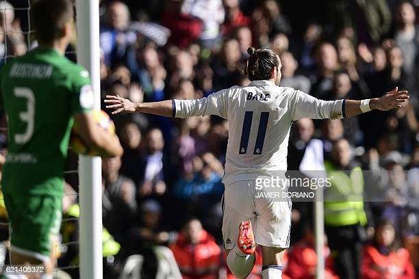 Real Madrid's Welsh forward Gareth Bale celebrates after scoring a goal during the Spanish league football match Real Madrid CF vs Club Deportivo...