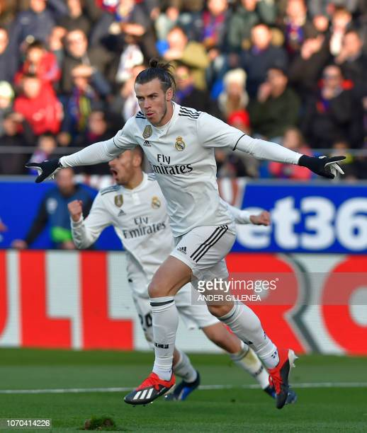 Real Madrid's Welsh forward Gareth Bale celebrates after scoring his team's first goal during the Spanish league football match between SD Huesca and...