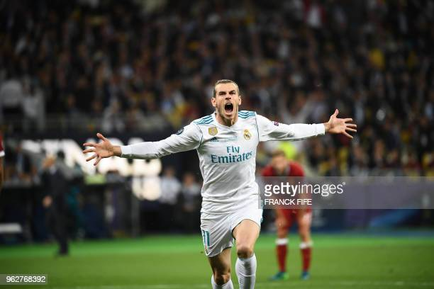 TOPSHOT Real Madrid's Welsh forward Gareth Bale celebrates after scoring his team's second goal during the UEFA Champions League final football match...