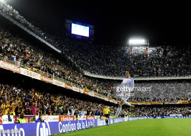 Real Madrid's Welsh forward Gareth Bale celebrates after scoring during the Spanish Copa del Rey final Clasico football match FC Barcelona vs Real...