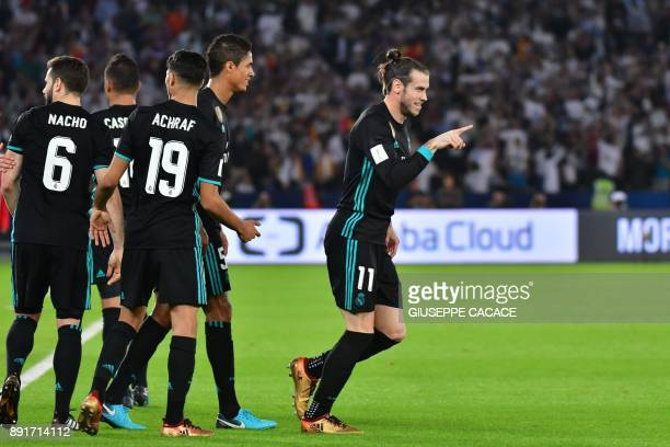 Real Madrid's Welsh forward Gareth Bale celebrates after scoring during the FIFA Club World Cup semifinal match in the Emirati capital Abu Dhabi on...
