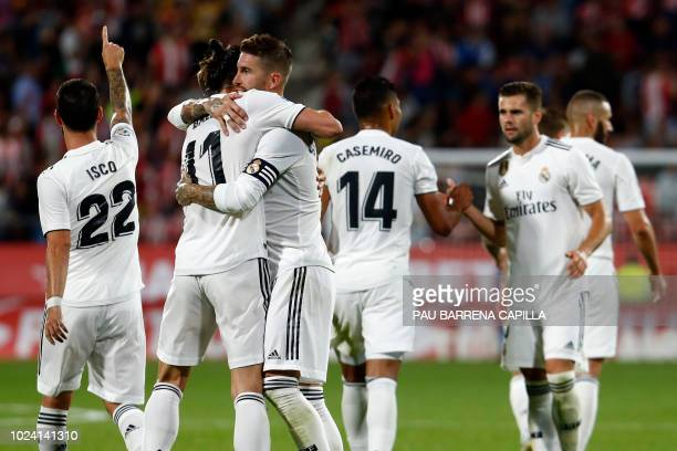 Real Madrid's Welsh forward Gareth Bale celebrates his goal with Real Madrid's Spanish defender Sergio Ramos during the Spanish league football match...